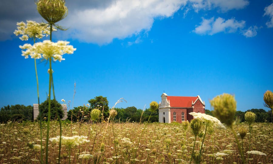 The Brick Chapel with Queen Anne's Lace in the foreground.
