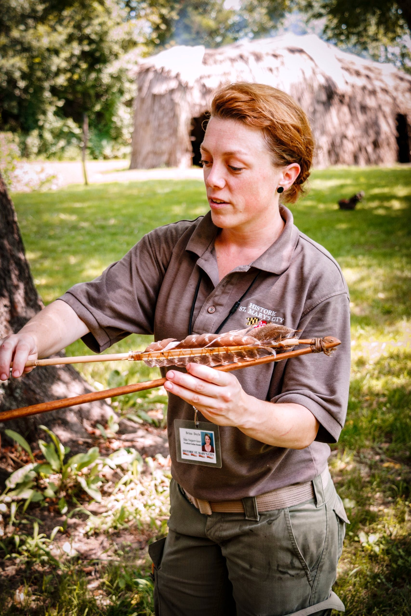 HSMC staff demonstrating how to use a spear throwing tool