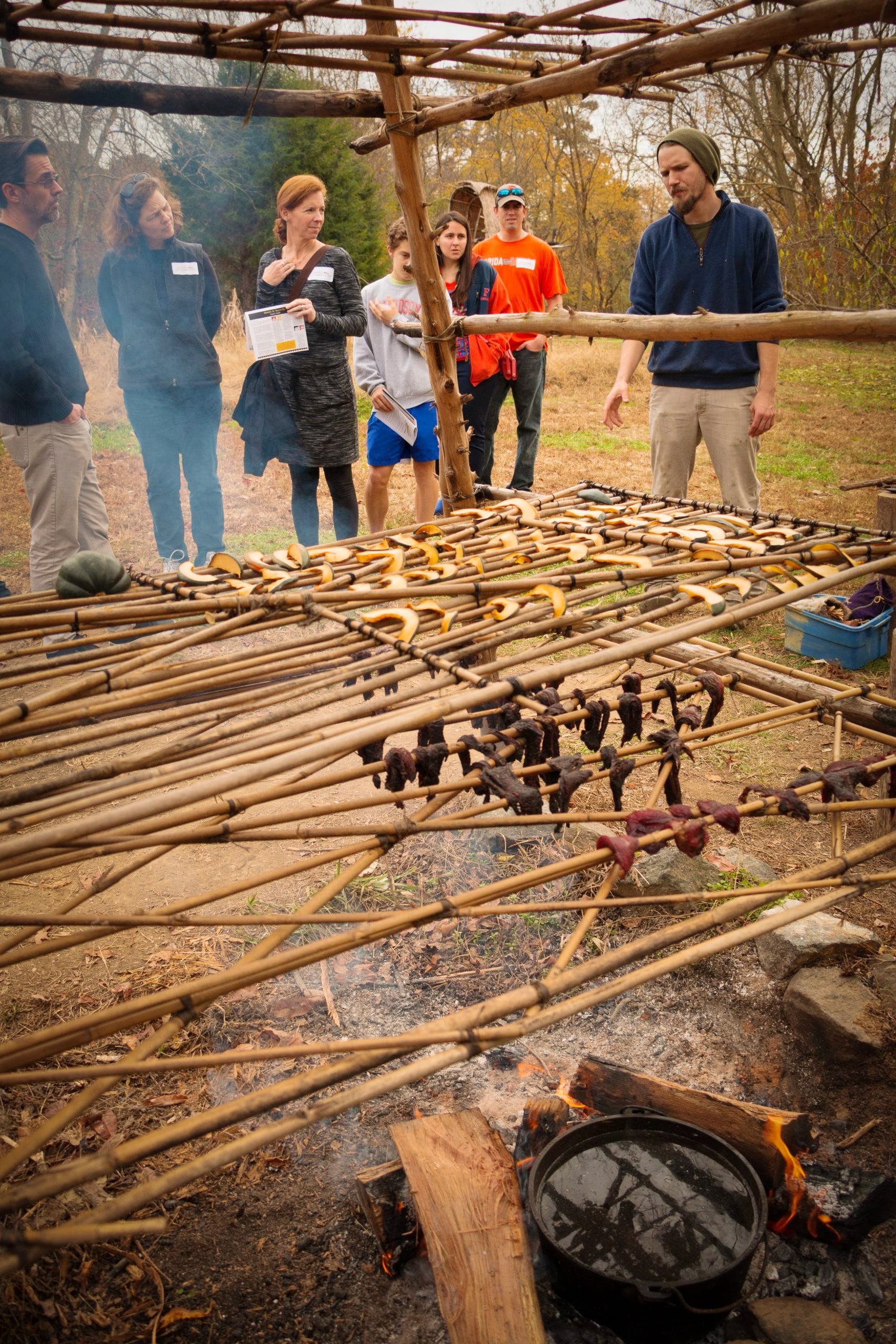 Visitors learning how the Yaocomoco people smoked and dried food