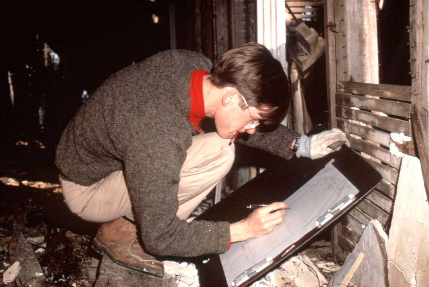 Cary Carson making architectural drawings of a colonial dwelling in 1972