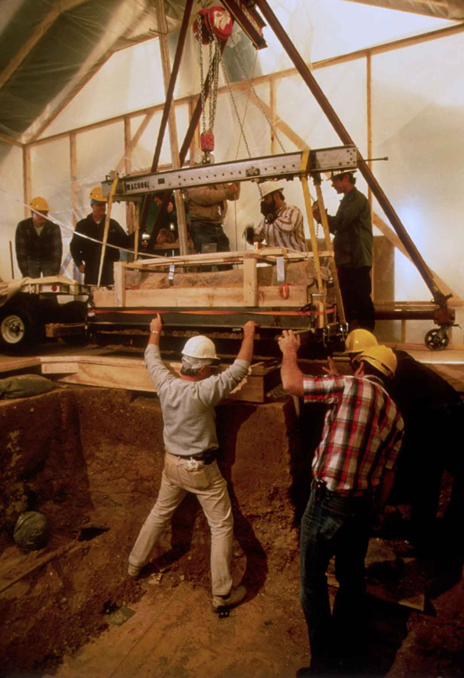 Lifting the lead coffins during removal for study