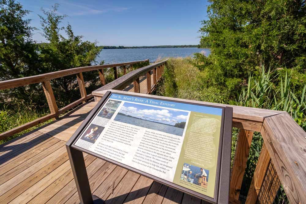 Follow the accessible boardwalk down to a quiet beach along the St. Mary's River